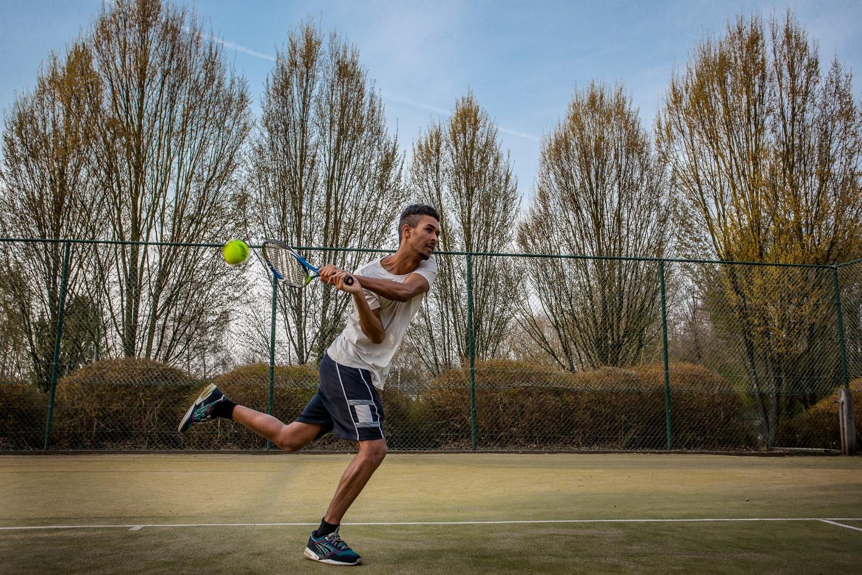Playing tennis using backhand